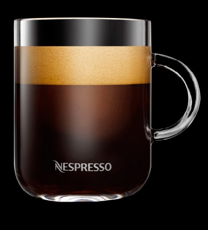 Cup of Nespresso coffee with rich, creamy layer of crema.